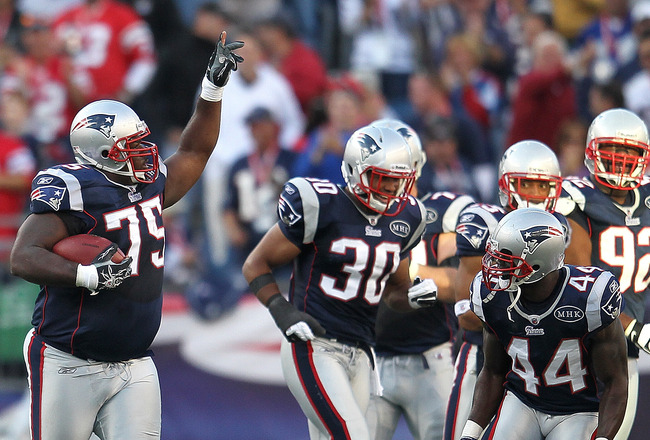 FOXBORO, MA -  SEPTEMBER 18:  Vince Wilfork #75 of the New England Patriots celebrates his interception and run with teammates against the San Diego Chargers in the first half at Gillette Stadium on September 18, 2011 in Foxboro, Massachusetts. (Photo by