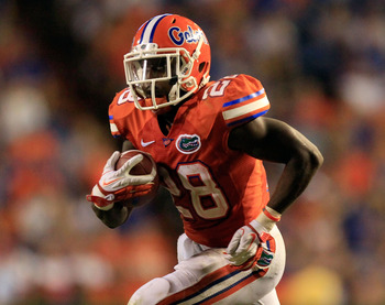 GAINESVILLE, FL - SEPTEMBER 03:  Jeff Demps #28 of the University Florida Gators runs for yardage during a game against the Florida Atlantic University Owls at Ben Hill Griffin Stadium on September 3, 2011 in Gainesville, Florida.  (Photo by Sam Greenwood