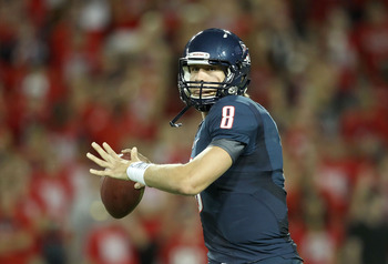 TUCSON, AZ - SEPTEMBER 17:  Quarterback Nick Foles #8 of the Arizona Wildcats throws a pass during the college football game against the Stanford Cardinal at Arizona Stadium on September 17, 2011 in Tucson, Arizona.  The Cardinal defeated the Wildcats 37-