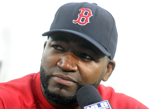 BOSTON, MA - SEPTEMBER 1: David Ortiz #34 of the Boston Red Sox  does an on field interview prior to play against the New York Yankees at Fenway Park on September 1, 2011 in Boston, Massachusetts. The Yankees won the game 4-2. (Photo by Darren McCollester