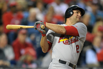 PHILADELPHIA, PA - SEPTEMBER 19: Lance Berkman #12 of the St. Louis Cardinals hits a home run in the first inning during the game against the Philadelphia Phillies at Citizens Bank Park on September 19, 2011 in Philadelphia, Pennsylvania. (Photo by Drew H