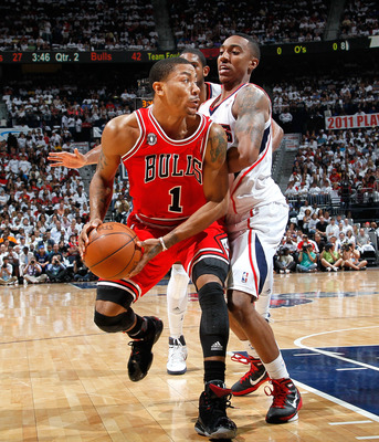 ATLANTA, GA - MAY 12:  Derrick Rose #1 of the Chicago Bulls against the Jeff Teague #0 of the Atlanta Hawks in Game Six of the Eastern Conference Semifinals in the 2011 NBA Playoffs at Phillips Arena on May 12, 2011 in Atlanta, Georgia.  NOTE TO USER: Use