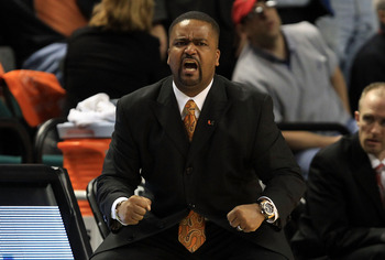 GREENSBORO, NC - MARCH 11:  Head coach Frank Haith of the Miami Hurricanes communicates with the team during the first half against the North Carolina Tar Heels in the quarterfinals of the 2011 ACC men's basketball tournament at the Greensboro Coliseum on