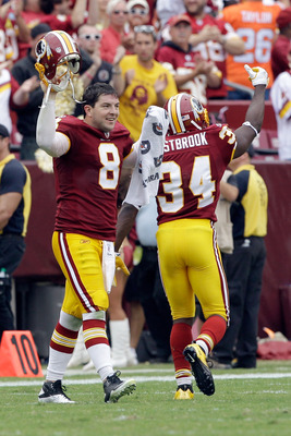 LANDOVER, MD - SEPTEMBER 18: Quarterback  Rex Grossman #8 of the Washington Redskins and  Byron Westbrook #34 celebrate during the closing moments of the Redskins 22-21 win over the Arizona Cardinals  during the second half at FedExField on September 18,