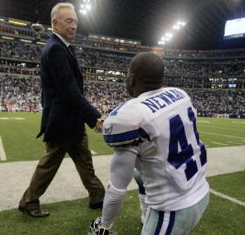 DALLAS - SEPTEMBER 17:  Dallas Cowboys team owner Jerry Jones greets cornerback Terrence Newman as he strides onto the field before the Cowboys play against the Washington Redskins at Texas Stadium in Dallas, Texas on September 17, 2006. Dallas eventually