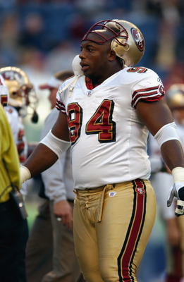 SEATTLE - OCTOBER 14:  Defensive tackle Dana Stubblefield #94 of the San Francisco 49ers looks on against the Seattle Seahawks during the game on October 14, 2002 at Seahawks Stadium in Seattle, Washington.  The 49ers won 28 -21.  (Photo by Otto Greule Jr