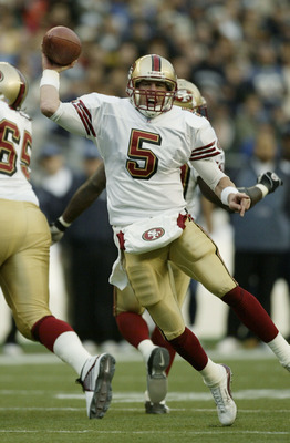 SEATTLE - OCTOBER 12:  Quarterback Jeff Garcia #5 of the San Francisco 49ers passes against the Seattle Seahawks on October12, 2003 at Seahawks Stadium in Seattle, Washington.  (Photo by Otto Greule Jr/Getty Images)