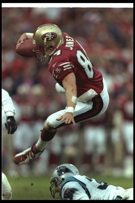8 Dec 1996: Tight end Brent Jones of the San Francisco 49ers hurdles a Carolina Panthers player during a game at 3Com Park in San Francisco, California. The Panthers won the game, 30-24.