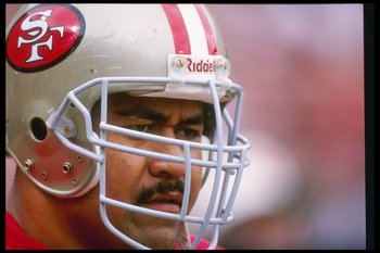 10 Sep 1995:  Offensive lineman Jesse Sapolu of the San Francisco 49ers looks on during a game against the Atlanta Falcons at 3Com Park in San Francisco, California.  The 49ers won the game, 41-10. Mandatory Credit: Jed Jacobsohn  /Allsport