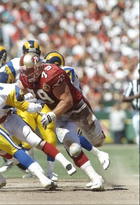8 Sep 1996: Tackle Harris Barton of the San Francisco 49ers throws a block during a game against the St. Louis Rams at 3Com Park in San Francisco, California. The 49ers won the game 34-0.