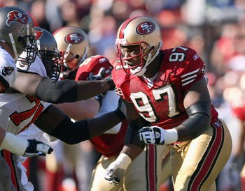 SAN FRANCISCO - DECEMBER 23: Bryant Young #97 of the San Francisco 49ers blocks the line in his last career home game against the Tampa Bay Buccaneers during an NFL game at Monster Park December 23, 2007 in San Francisco, California. (Photo by Jed Jacobso