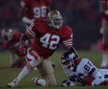 3 Dec 1990:  Strong safety Ronnie Lott of the San Francisco 49ers gives a little smile to one of his teammates as he finishes off a tackle during the 49ers 7-3 victory over the New York Giants at Candlestick Park in San Francisco, California.   Mandatory