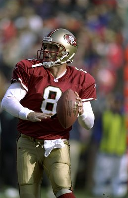 27 Dec 1998: Steve Young #8 of the San Francisco 49ers throws the ball during the game against the St Louis Rams at the 3Com Park in San Francisco, California. The 49ers defeated the Rams 38-19. Mandatory Credit: Jed Jacobsohn  /Allsport