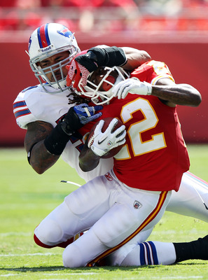 KANSAS CITY, MO - SEPTEMBER 11:   Dexter McCluster #22 of the Kansas City Chiefs is brought down by Shawne Merriman #56 of the Buffalo Bills during the game at Arrowhead Stadium on September 11, 2011 in Kansas City, Missouri.  (Photo by Jamie Squire/Getty