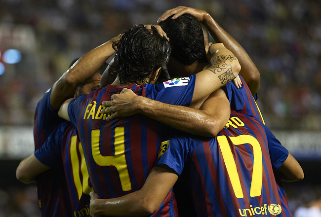 VALENCIA, SPAIN - SEPTEMBER 21:  Players of Barcelona celebrate during the La Liga match between Valencia and Barcelona at Estadio Mestalla on September 21, 2011 in Valencia, Spain.  (Photo by Manuel Queimadelos Alonso/Getty Images)