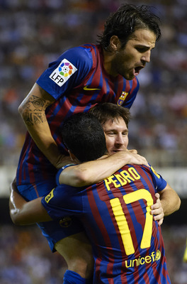 VALENCIA, SPAIN - SEPTEMBER 21:  Pedro Rodriguez of Barcelona celebrates with his teammates Lionel Messi and Cesc Fabregas during the La Liga match between Valencia and Barcelona at Estadio Mestalla on September 21, 2011 in Valencia, Spain.  (Photo by Man