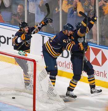 BUFFALO, NY - APRIL 24: Drew Stafford #21, Tyler Myers #57 and Thomas Vanek #26 of the Buffalo Sabres celebrate the first of two goals by Vanek in the first period against the Philadelphia Flyers in Game Six of the Eastern Conference Quarterfinals during