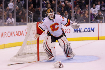 LOS ANGELES, CA - MARCH 21:  Goaltender Miikka Kiprusoff #34 of the Calgary Flames loses his stick and blocker during their NHL game against the Los Angeles Kings at Staples Center on March 21, 2011 in Los Angeles, California. The Kings defeated the Flame