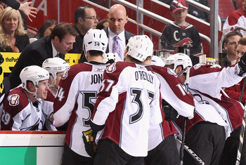 GLENDALE, AZ - APRIL 01:  The Colorado Avalanche listen to head coach Joe Sacco during a time out in the NHL game against the Phoenix Coyotes at Jobing.com Arena on April 1, 2011 in Glendale, Arizona. The Avalanche defeated the Coyotes 4-3 in an overtime 