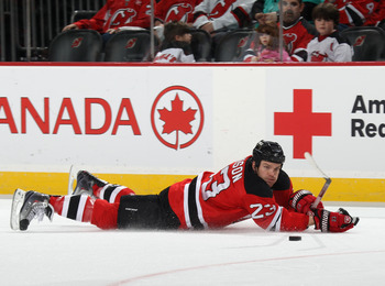 NEWARK, NJ - APRIL 10: David Clarkson #23 of the New Jersey Devils skates against the Boston Bruins at the Prudential Center on April 10, 2011 in Newark, New Jersey.  (Photo by Bruce Bennett/Getty Images)