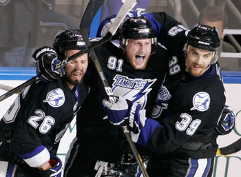 TAMPA, FL - MAY 25:  Martin St. Louis #26 celebrates his third period goal with Steven Stamkos #91 and Mike Lundin #39 of the Tampa Bay Lightning in Game Six of the Eastern Conference Finals against the Boston Bruins during the 2011 NHL Stanley Cup Playof