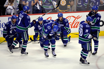VANCOUVER, BC - JUNE 15:  The Vancouver Canucks react after being defeated by the Boston Bruins in Game Seven of the 2011 NHL Stanley Cup Final at Rogers Arena on June 15, 2011 in Vancouver, British Columbia, Canada. The Boston Bruins defeated the Vancouv