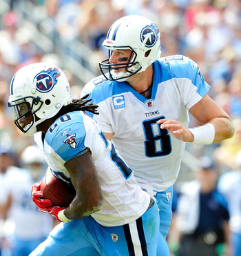 NASHVILLE, TN - SEPTEMBER 18:  Matt Hasselbeck #8 hands off to Chris Johnson #28 of the Tennessee Titans against the Baltimore Ravens at LP Field on September 18, 2011 in Nashville, Tennessee. Tennessee won 26-13.  (Photo by Grant Halverson/Getty Images)