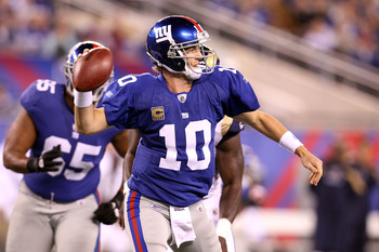 EAST RUTHERFORD, NJ - SEPTEMBER 19:  Eli Manning #10 of the New York Giants throws a pass in the first quarter against the St. Louis Rams at MetLife Stadium on September 19, 2011 in East Rutherford, New Jersey.  (Photo by Al Bello/Getty Images)