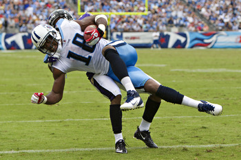 NASHVILLE, TN - SEPTEMBER 18:   Kenny Britt #18 of the Tennessee Titan is tackled in the end zone after catching a pass for a touchdown during a game against the Baltimore Ravens at the LP Field on September 18, 2011 in Nashville, Tennessee.  The Titans d
