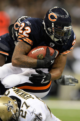 NEW ORLEANS, LA - SEPTEMBER 18:  Malcolm Jenkins #27 of the New Orleans Saints tackles Matt Forte #22 of the Chicago Bears at the Louisiana Superdome on September 18, 2011 in New Orleans, Louisiana.  The Saints defeated the Bears 30-13.   (Photo by Stacy