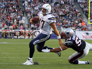 FOXBORO, MA -  SEPTEMBER 18:   Philip Rivers #17 of the San Diego Chargers is chased by  Rob Ninkovich #50 of the New England Patriots in the second half at Gillette Stadium on September 18, 2011 in Foxboro, Massachusetts. (Photo by Jim Rogash/Getty Image