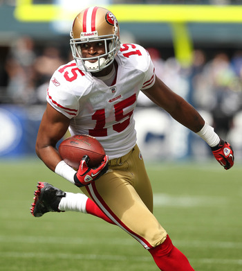 SEATTLE - SEPTEMBER 12:  Wide receiver Michael Crabtree #15 of the San Francisco 49ers rushes during the NFL season opener against the Seattle Seahawks at Qwest Field on September 12, 2010 in Seattle, Washington. (Photo by Otto Greule Jr/Getty Images)