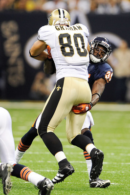 NEW ORLEANS, LA - SEPTEMBER 18:  Jimmy Graham #80 of the New Orleans Saints is brought down by Zackary Bowman #35 of the Chicago Bears at the Louisiana Superdome on September 18, 2011 in New Orleans, Louisiana.  The Saints defeated the Bears 30-13.  (Phot
