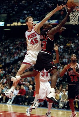 13 Dec 1996:  Guard Michael Jordan of the Chicago Bulls goes up for two as New Jersey Nets center Shawn Bradley covers him during a game at the Continental Airlines Arena in East Rutherford, New Jersey.  The Bulls won the game, 114-92. Mandatory Credit: A
