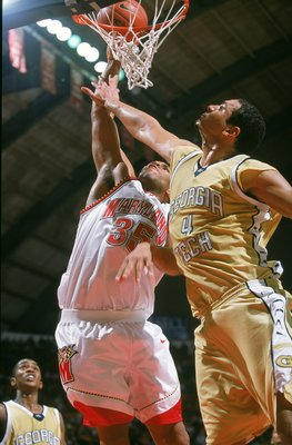 6 Jan 2001:  Lonny Baxter #35 of the Maryland Terrapins makes a layup as he blocked by Alvin Jones #5 of the Georgia Tech Yellow Jackets at the Cole Field House in College Park, Maryland.  The Terrapins defeated the Yellow Jackets 93-80.Mandatory Credit: