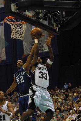 14 May 2001: Antonio Daniels #33 of the San Antonio Spurs  is fouled by Calvin Booth #52 of the Dallas Mavericks during game 5 of the Western Conference Payoff Semifinals at the Alamo Dome in San Antonio, Texas. DIGITAL IMAGE Mandatory Credit: Tom Hauck/A