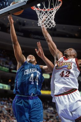 15 Feb 2000:  Theo Ratliff #42 of the Philadelphia 76ers tries to block the shot to the hoop by Derrick Coleman #44 of the Charlotte Hornets during the game at the First Union Center in Philadelphia, Pennsylvania. The Hornets defeated the 76ers 95-93.   M