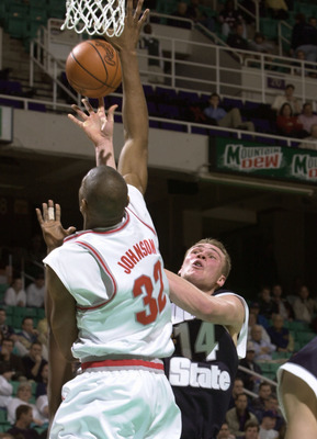15 Mar 2001:  Dimitri Jorssen #14 of Utah State takes a shot while guarded by Ken Johnson #32 of Ohio State in the first round of the Men's NCAA Tournament at Greensboro Coliseum in Greensboro, North Carolina.  DIGITAL IMAGE  Mandatory Credit: Ezra Shaw/A