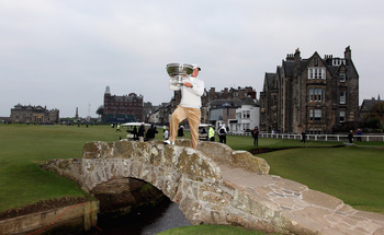 ST ANDREWS, SCOTLAND - OCTOBER 10:  Martin Kaymer of Germany holds the trophy on the Swilken Bridge after his victory in the final round of The Alfred Dunhill Links Championship at The Old Course on October 10, 2010 in St Andrews, Scotland.  (Photo by Ros