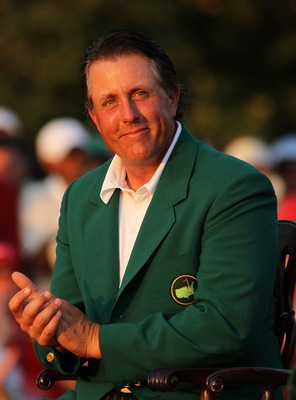 AUGUSTA, GA - APRIL 10:  Phil Mickelson claps while in attendance at the green jacket presentation after Charl Schwartzel's two-stroke victory at the 2011 Masters Tournament at Augusta National Golf Club on April 10, 2011 in Augusta, Georgia.  (Photo by J