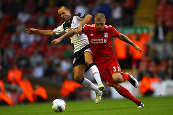 LIVERPOOL, ENGLAND - AUGUST 27:  Martin Petrov of Bolton Wanderers and Martin Skrtel of Liverpool battle for the ball during the Barclays Premier League match between Liverpool and Bolton Wanderers at Anfield on August 27, 2011 in Liverpool, England.  (Ph