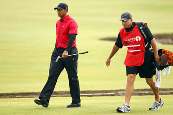 ST ANDREWS, SCOTLAND - JULY 18:  Tiger Woods of the USA walks on the first green alongside his caddie Steve Williams during the final round of the 139th Open Championship on the Old Course, St Andrews on July 18, 2010 in St Andrews, Scotland.  (Photo by R