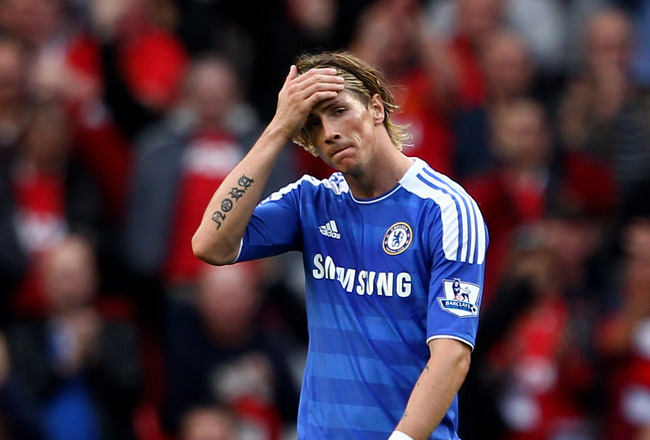 MANCHESTER, ENGLAND - SEPTEMBER 18:  Fernando Torres of Chelsea looks dejected during the Barclays Premier League match between Manchester United and Chelsea at Old Trafford on September 18, 2011 in Manchester, England.  (Photo by Clive Brunskill/Getty Im
