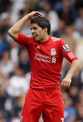 LONDON, ENGLAND - SEPTEMBER 18:  Frustrated Luis Suarez of Liverpool reacts to a decision by the assistant referee during the Barclays Premier League match between Tottenham Hotspur and Liverpool at White Hart Lane on September 18, 2011 in London, England