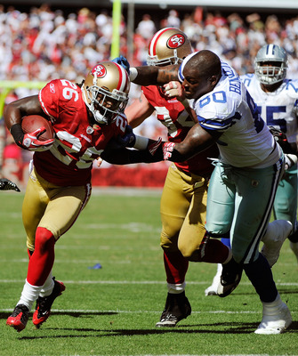 SAN FRANCISCO, CA - SEPTEMBER 18: Tramaine Brock #26 of the San Francisco 49ers running back an interception tries to get away from Martellus Bennett #80 of the Dallas Cowboys in the third quarter of an NFL football game at Candlestick Park on September 1