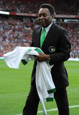 MANCHESTER, ENGLAND - AUGUST 05:  Pele holds a signed shirt prior to Paul Scholes' Testimonial Match between Manchester United and New York Cosmos at Old Trafford on August 5, 2011 in Manchester, England.  (Photo by Chris Brunskill/Getty Images)