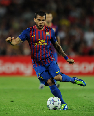 BARCELONA, SPAIN - SEPTEMBER 13: Daniel Alves of FC Barcelona controls the ball during the UEFA Champions League group H match between FC Barcelona and AC Milan at the Camp Nou stadium on September 13, 2011 in Barcelona, Spain.  (Photo by Jasper Juinen/Ge