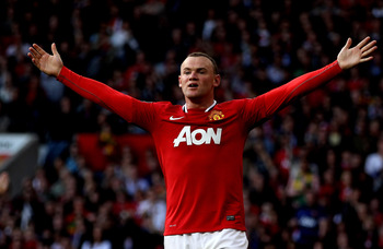 MANCHESTER, ENGLAND - SEPTEMBER 18:  Wayne Rooney of Manchester United reacts during the Barclays Premier League match between Manchester United and Chelsea at Old Trafford on September 18, 2011 in Manchester, England.  (Photo by Clive Brunskill/Getty Ima