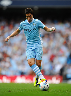 MANCHESTER, ENGLAND - SEPTEMBER 10:  Samir Nasri of Manchester City in action during the Barclays Premier League match between Manchester City and Wigan Athletic at Etihad Stadium on September 10, 2011 in Manchester, England.  (Photo by Laurence Griffiths