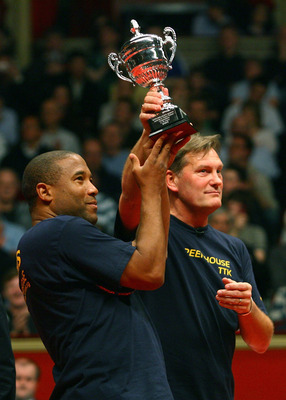 LONDON - MARCH 17:  Ex football players Glenn Hoddle and John Barnes lift the trophy after winning a charity match during the Dunlop Table Tennis Masters at the Royal Albert Hall on March 17, 2008 in London, England.  (Photo by Julian Finney/Getty Images)